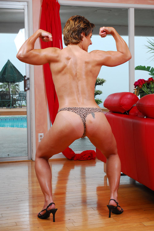 Nude female bodybuilder back muscles