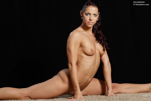 Flexible nude gymnast in the front splits