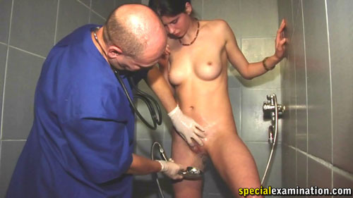 Washing a submissive pussy in the medical fetish shower