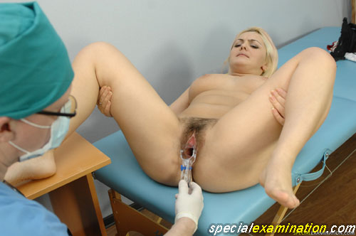 Gynecological speculum insertion in a hairy pussy